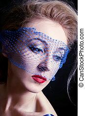young beautiful blue-eyed women in veils