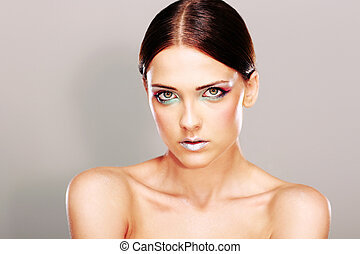 Portrait of a young beautiful woman with lovely fresh skin