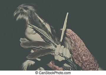 young woman with feathers in hand