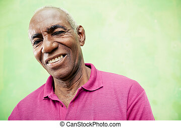 Old people and emotions, portrait of senior african american man looking and smiling at camera. Copy space