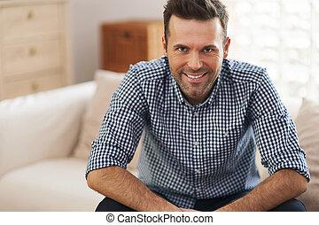 Portrait of handsome man in living room
