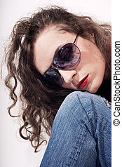 young beautiful curly woman in sunglasses