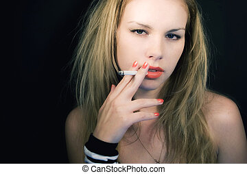 Portrait of young fair-haired girl with cigarette