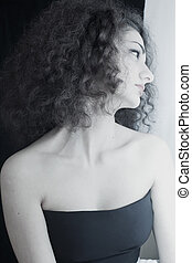 Portrait of young girl with curly hair