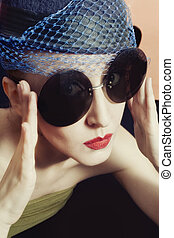 Portrait young women in veils and round sunglasses