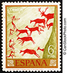 SPAIN - CIRCA 1962: a stamp printed in the Spain shows Hunters and Deer Herd, Wall Painting found in Spanish Cave, circa 1962
