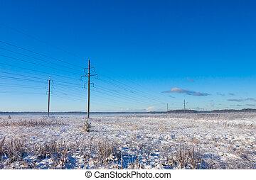 Power lines in winter snow field