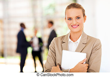 pretty corporate worker with tablet computer in office