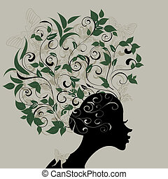 Profile of a girl with hair decorated with leaves