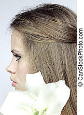 Profile the girl with a lily