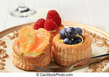 Puff pastry shells filled with custard and fresh fruit