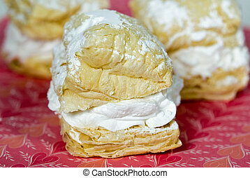 Extreme close up of puff pastry on Valentine paper.