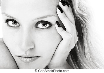 Black and white close-up portrait of young girl with beautiful eyes