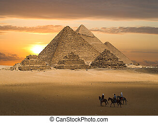 The Pyramids of Gizeh near Cairo in Egypt during a golden sunset.