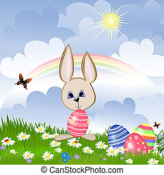 Rabbit with Easter eggs on lawn