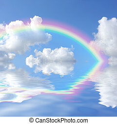 Abstract of a blue sky with cumulus clouds and a rainbow reflected over water.