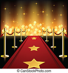 Red carpet in front of defocused light, covered with golden stars.