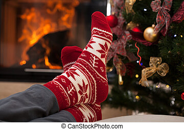 Relaxation after christmas in cozy interior with fireplace