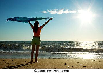 Girl relax on beach. Emotional scene.