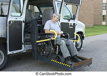 disabled man operating the remote control on a handicapped lift van