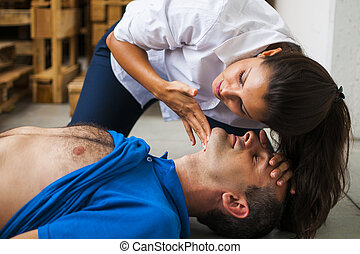 rescuer assisting unconscious man