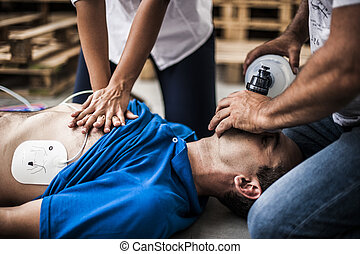 rescuers assisting with CPR