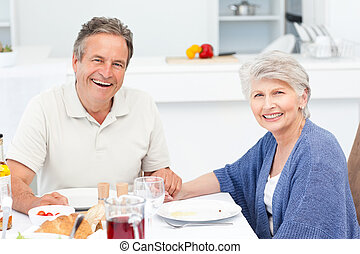 Retired couple eating in the kitchen