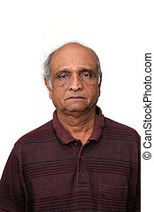 an old indian senior loking very sad about his retirement