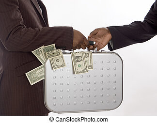This is image of businessman making handing over a briefcase of money.