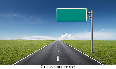 empty road through fields with blank road-sign