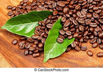 Roasted coffee beans on wood. (Arabica coffee)