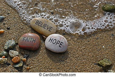 faith, hope, believe rocks in the water with a wave coming toward them.