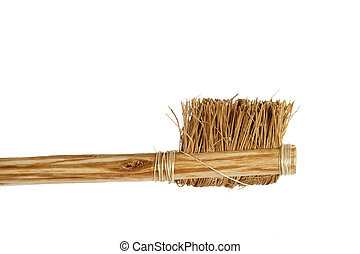 A large very rough bristle tooth brush.