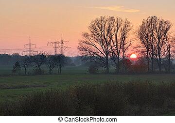 Rural landscape in Mecklenburg-Vorpommern, Germany, in the autumnal sunset.