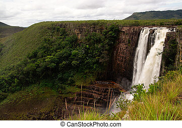 Magnificent waterfall, salto in spanish, called Aponwao in Gran sabana, Venezuela with mountains in background