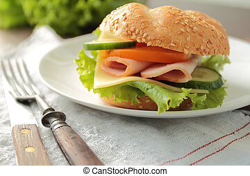 Sandwich with fresh lettuce, cheese, ham, tomato and cucumber