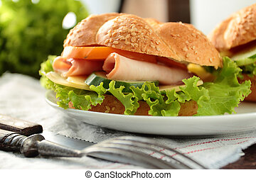 Sandwich with fresh lettuce, tomato, ham and cheese