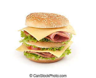 sandwich with ham, cheese and vegetables on white background