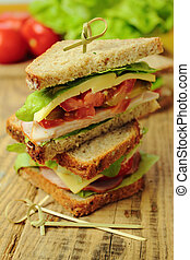 Sandwich with ham, cheese, toamtoes and fresh lettuce