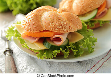 Sandwich with tasty ham and vegetables