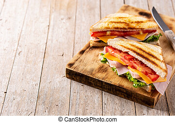 Sandwich with tomato,lettuce,ham and cheese