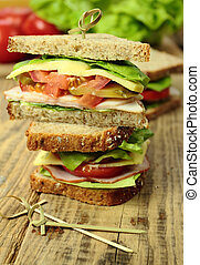 Sandwiches with fresh vegetables, cheese and ham