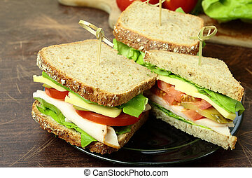 Sandwiches with fresh vegetables ham and cheese