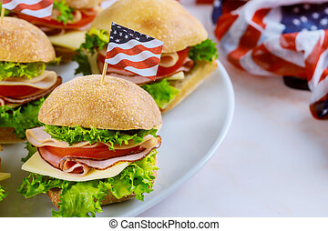 Sandwiches with ham, cheese and tomato for american holiday table.