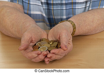 Female senior with money - isolated on white background