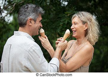 senior couple eating ice creams