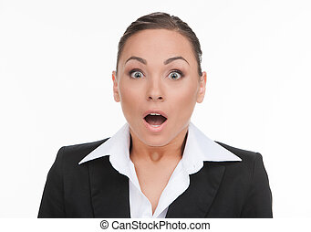 Shocked businesswoman. Portrait of surprised young businesswoman looking at camera and keeping his mouth open while isolated on white