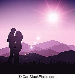 silhouette of couple in landscape
