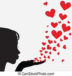 Silhouette woman blowing heart