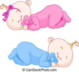 Two charming little twins sleep in pajamas